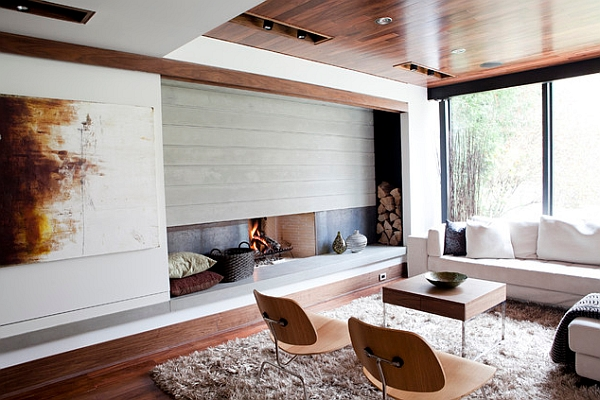 This midcentury modern fireplace gives the room some modern edge to help tone down the warmth of the wood flooring and accent ceiling.
