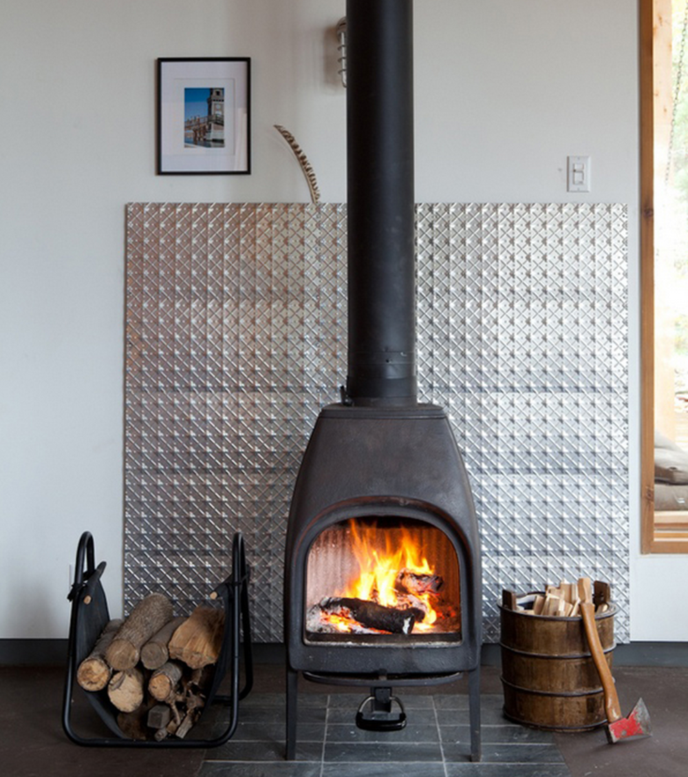 If your place doesn't have a fireplace, you can add a standalone one to give it a woodsy look.
