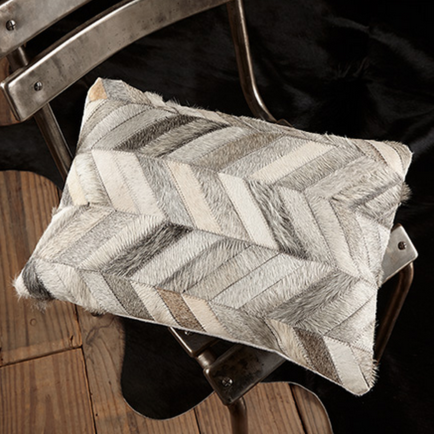 For those who love a more rustic and organic look, Arhuas' Cowhide pillow in a herringbone pattern has the perfect neutral-tone palatte without sacrificing texture.