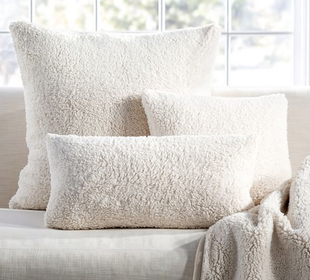 If you're looking for something extra cuddly this season, give Pottery Barn's Faux Sheepskin pillows a try.