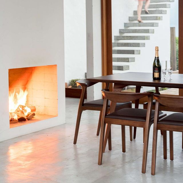 The fireplace warms up this indoor/outdoor dining space.