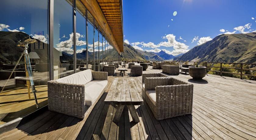 Hotel Kazbegi's outdoor deck will leave you breathless.  From the reflective windows to the clear blue skies and wicker furniture, this place is a sight to be seen.