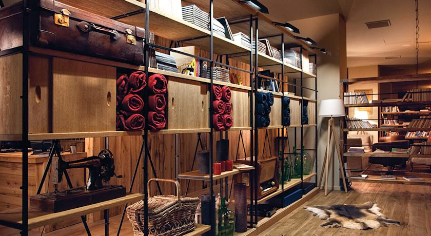 Hotel Kazbegi's industrial shelving is decorated with the style and grace of any chic Soho loft.