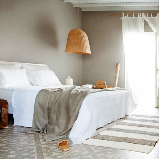 Another beautiful bedroom option is to have decorative tile flooring, rich neutral striped floor rug and wicker lamp shade.