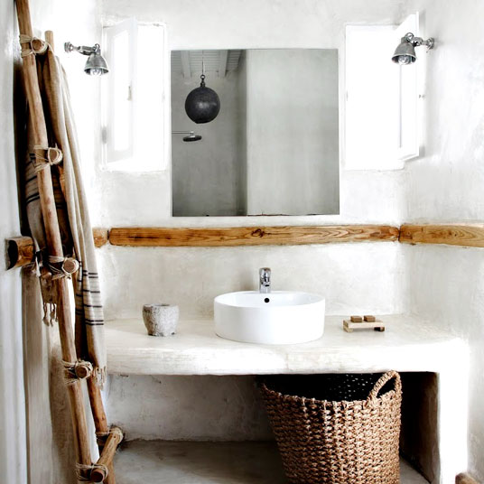 This Greek minimalist boho bathroom is the perfect look for those who want the latest in home design.  The hand-tied ladder to hang towels is gorgeous.  A rustic wood shelf is a great alternative to a medicine cabinet.