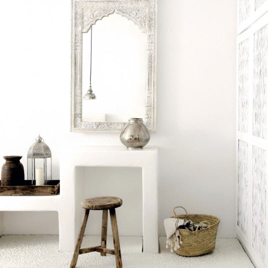 Instead of a formal vanity to apply makeup or pay bills, add a built-in and complete it with a rustic stool and Moroccan-framed vanity mirror.  Dial it up to a ten with Moroccan candle lanterns and Turkish hand towels.