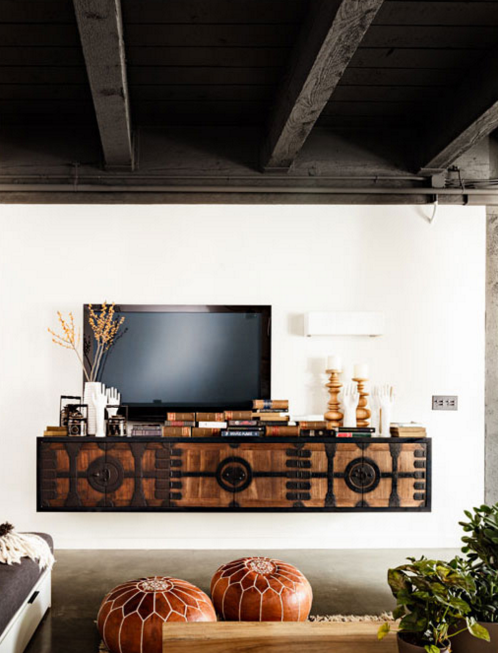 This gorgeous media center credenza pairs perfectly with the boho leather poufs.
