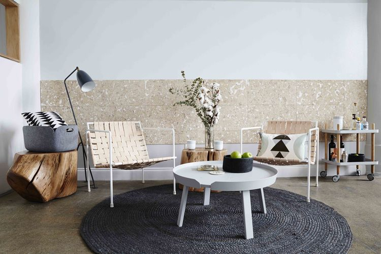 Dots seating area is a Scandinavian designer's dream.  Complete with rustic tree stump side tables and a bar cart full for Fridays.