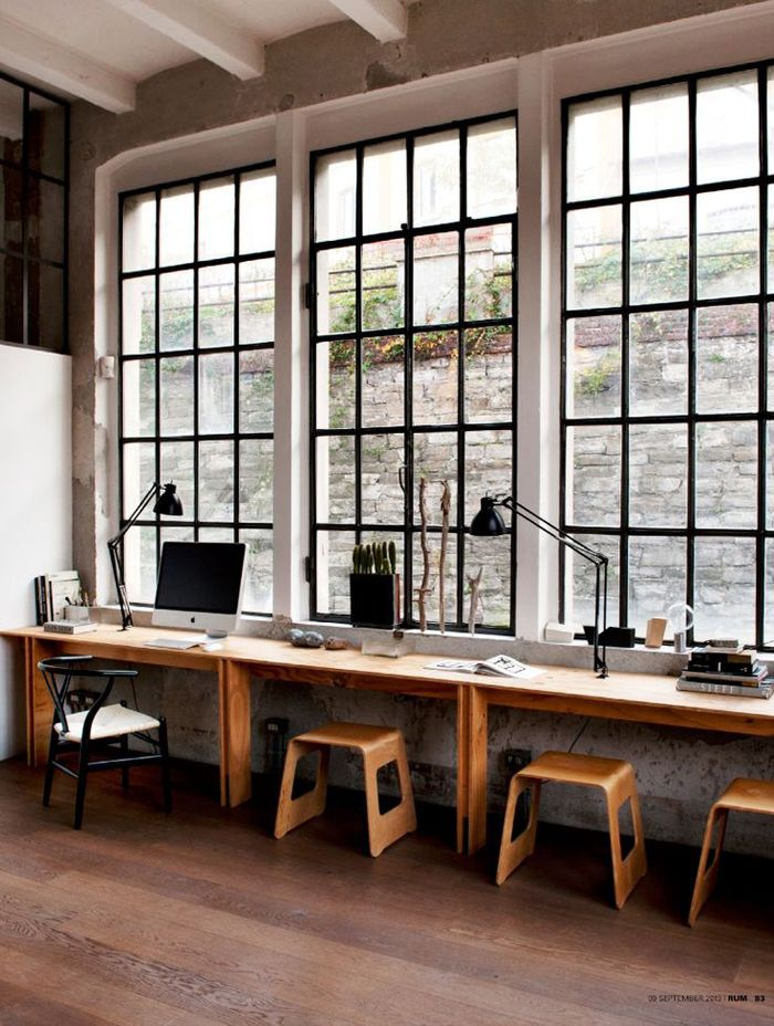 This industrial office with exposed brick is just too pretty.
