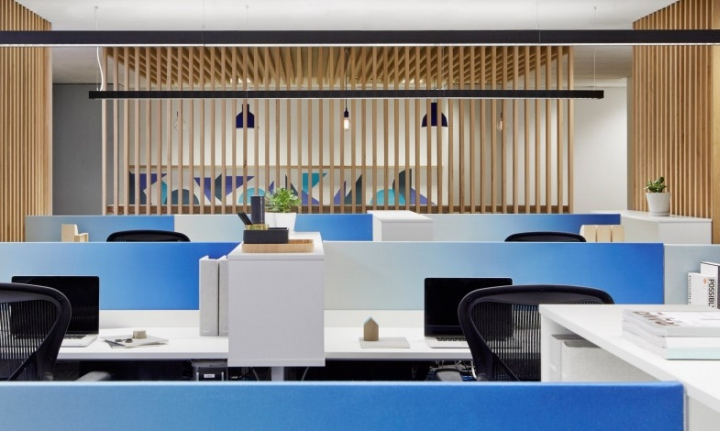 While I'm not a huge fan of cubicles, these are next generation.  The bright blue hues and low height feel more like a cool office and less like a desk from the movie Office Space.
