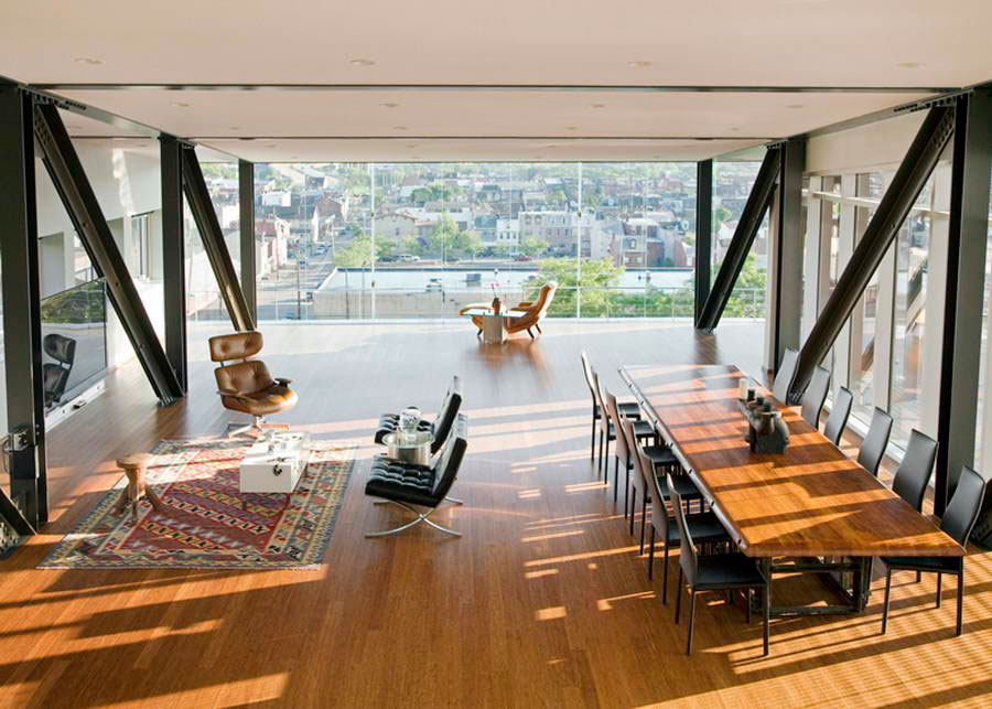 Yes, this is a HOME office.  It's pretty incredible.  I love how it has a relaxed seating area for informal meetings, a conference table for negotiations, and a desk overlooking the city.