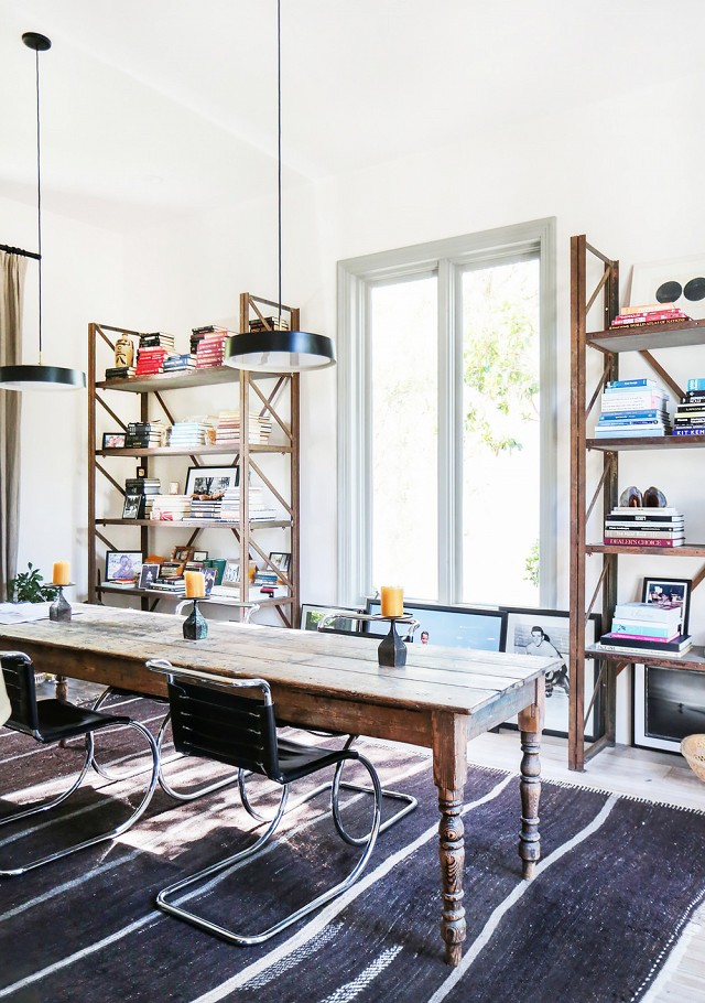 I'm obsessed with this antique table and bookshelves in this Malibu home.