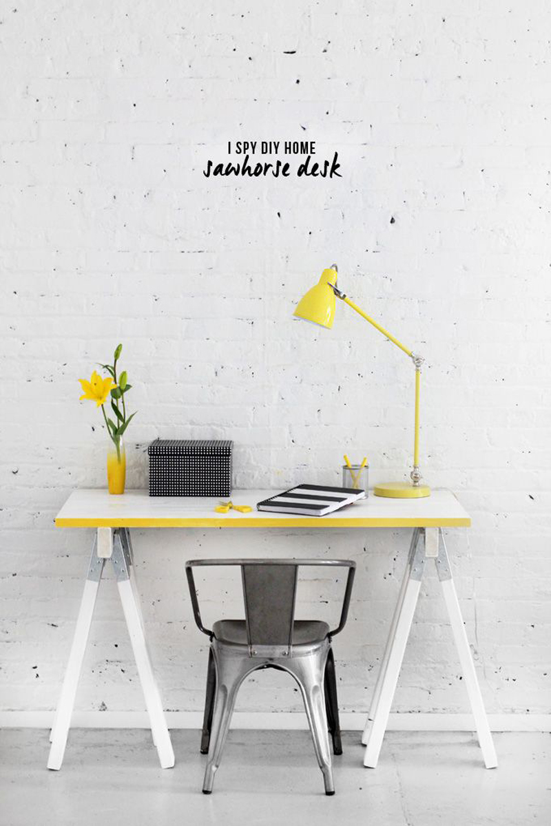 This yellow desk and table lamp are the perfect pop of color for an otherwise neutral-toned office.
