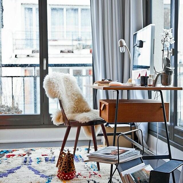 This boho glam office is everything!  I'm a sucker for a beautiful Moroccan boucherouite rug and sheep blanket.