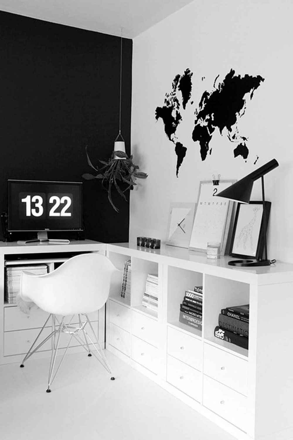 If investing in artwork isn't an option, why not create your own!?  This office used a stencil to add a globe.  It's perfect for pinning thumbnails when planning global deals as well.