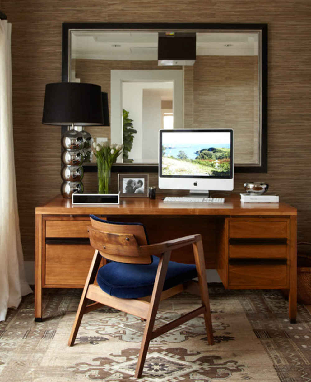 I love this stylish home office.  With that said, I would advise against that table lamp that looks like it was borrowed from a Marriott.