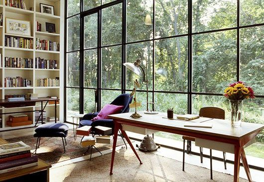 If only every office could look like this midcentury modern workspace with floor to ceiling industrial windows.