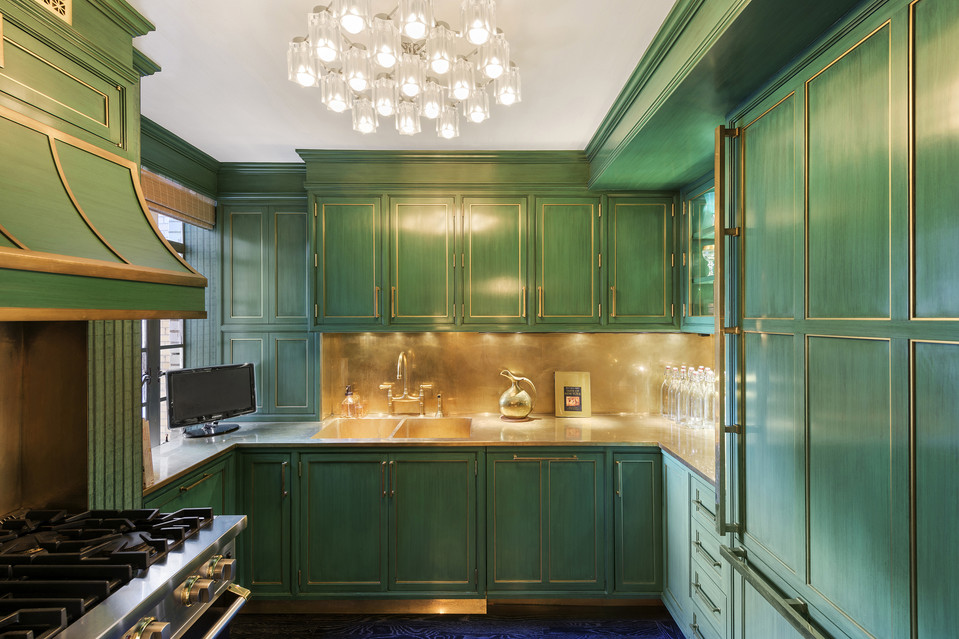 This green and gold gilded kitchen is rich in texture.