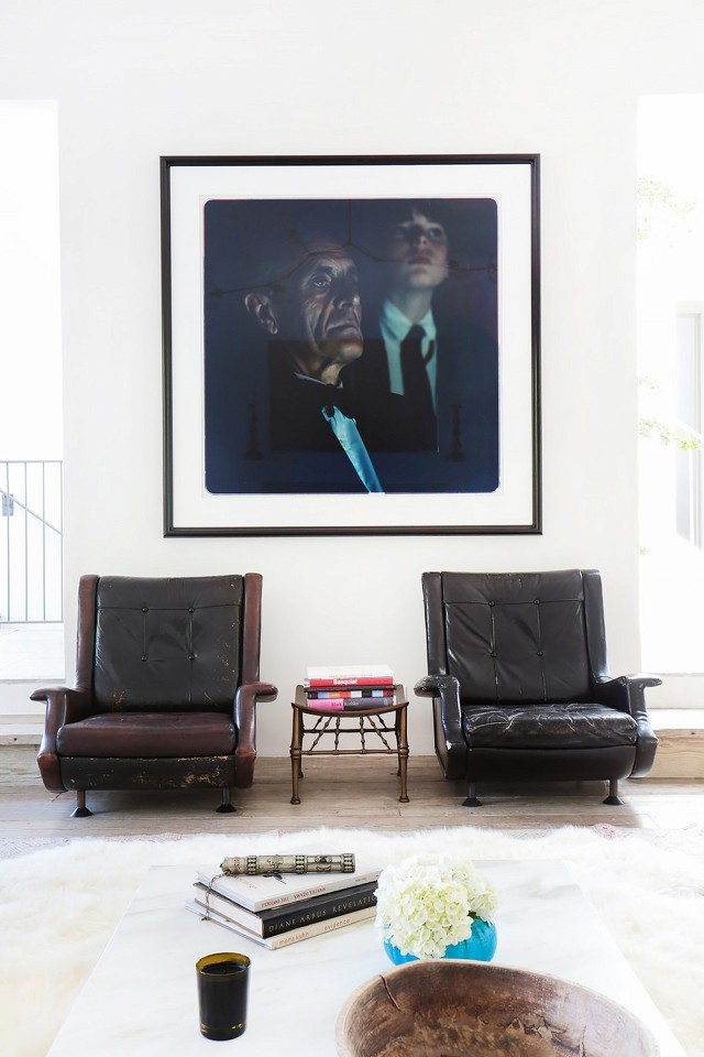 I'm a sucker for worn in antique leather chairs and contemporary art.