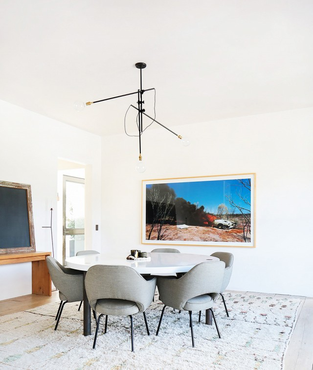 The formal dining room is perfectly accented with a boucherouite rug and contemporary art.  She has great taste in art.
