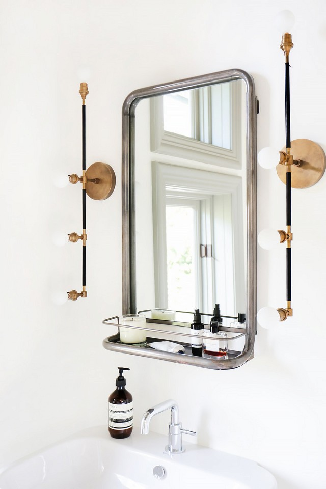 The bathroom lighting and cubby for this mirror is so sleek!
