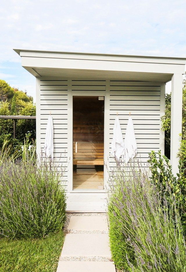 The sauna is housed among lavender plants.
