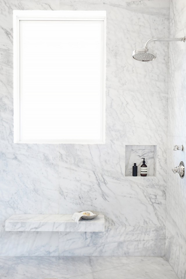 This marble shower is sure to please both minimalists and midcentury modern fans.