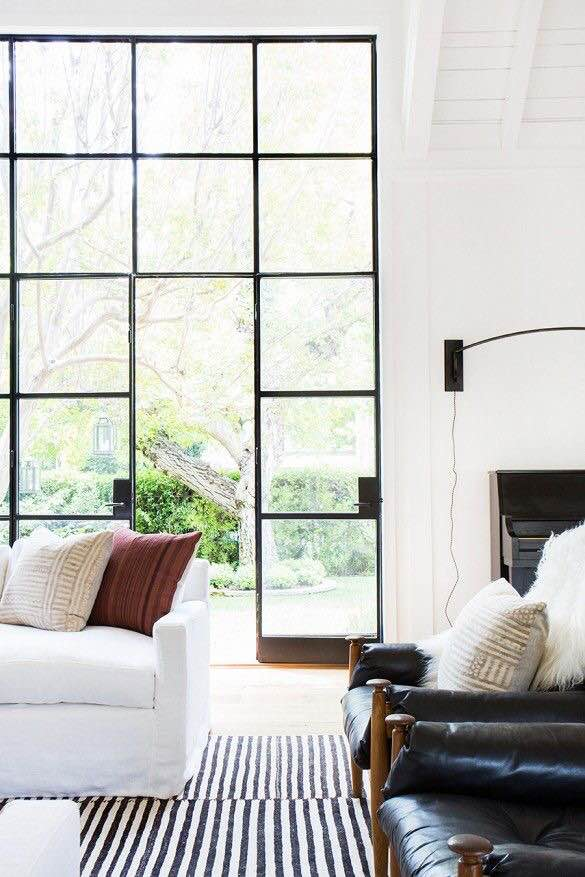 If only every living room could look this chic.  I'm obsessed with the industrial-paned glass doors in this home.  Large windows are by far the best design choice anyone can make.