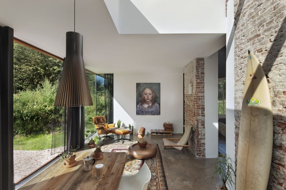 Pairing classic art portraits with modern furniture create effortless style in this Dutch home.