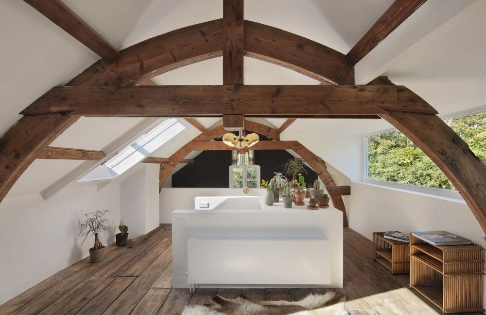 This upstairs den is hands down one of the best in the world.  The warmth of the rustic wood beams, skylights, and succulents provide a sanctuary within one's home.