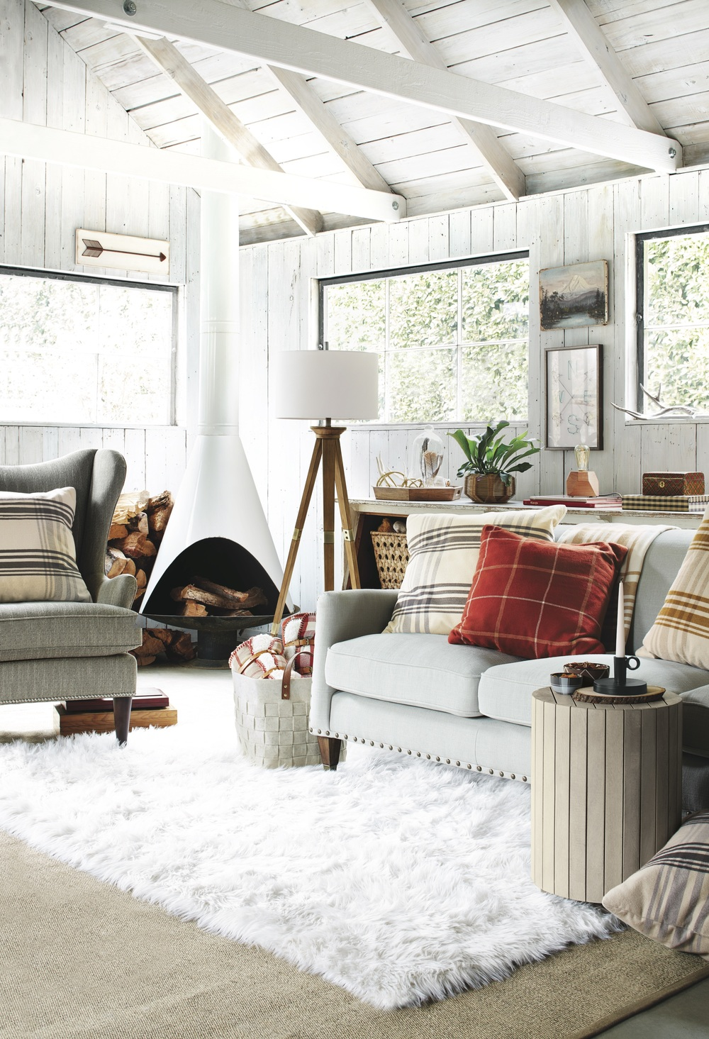 The white washed wood beams and vaulted ceiling create the perfect earthy setting for Target's Nordic inspired Winter collection.