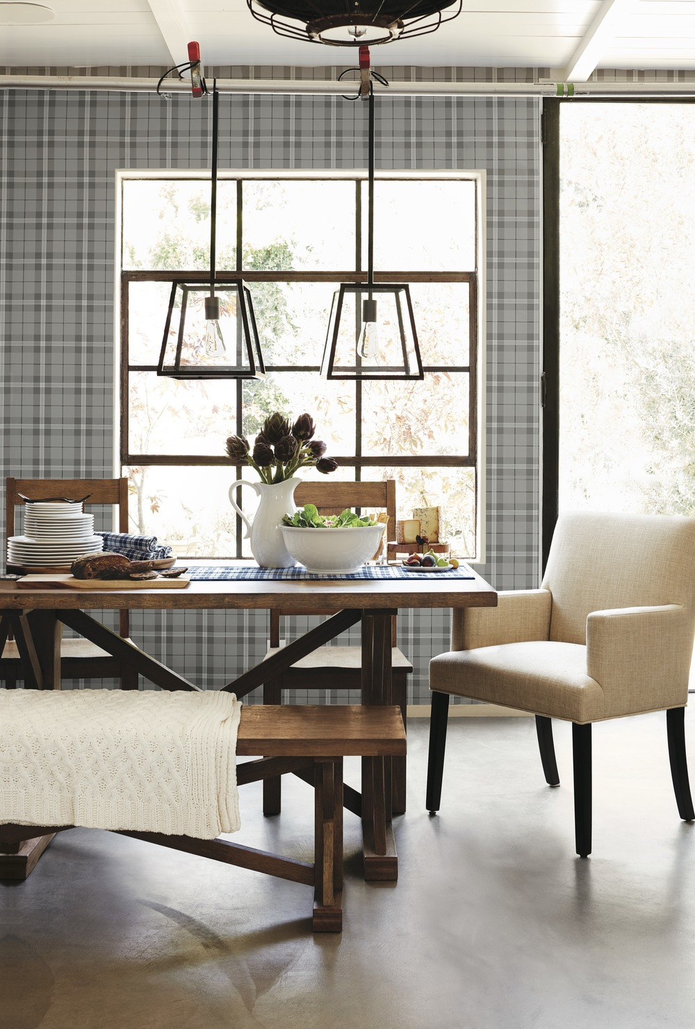 For a post-holiday brunch, mix and match a blue plaid table runner with a cable knit throw to give the room a winter feel without an overdose on holiday cheer, like these from Target.
