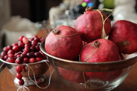 Make centerpieces from ripe jewel-toned fruit.  Pomegranates, cranberries, pears, figs and more are sure to create a delectable table presentation.