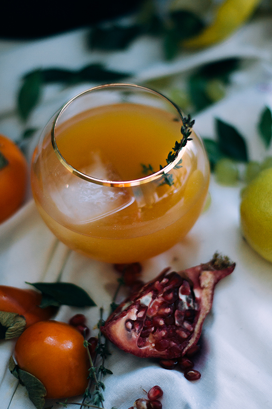 It wouldn't be the holidays, without a scrumptious drink.  Create a festive twist by adding fresh thyme as garnish.