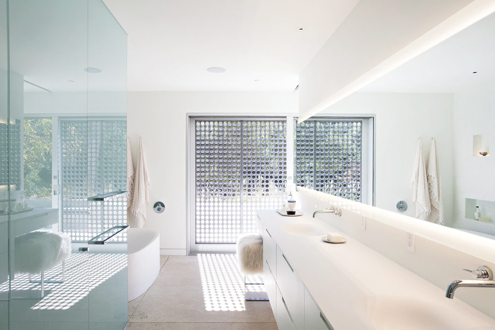 This midcentury modern bathroom includes modern amenities including a beautiful soaking tub.