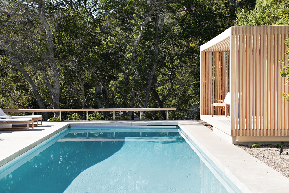 The pool cabana in this home creates the perfect covered deck for entertaining.