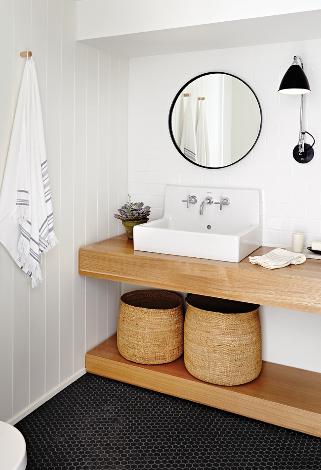 The low ledge adds a modern edge to this organic modern bathroom.