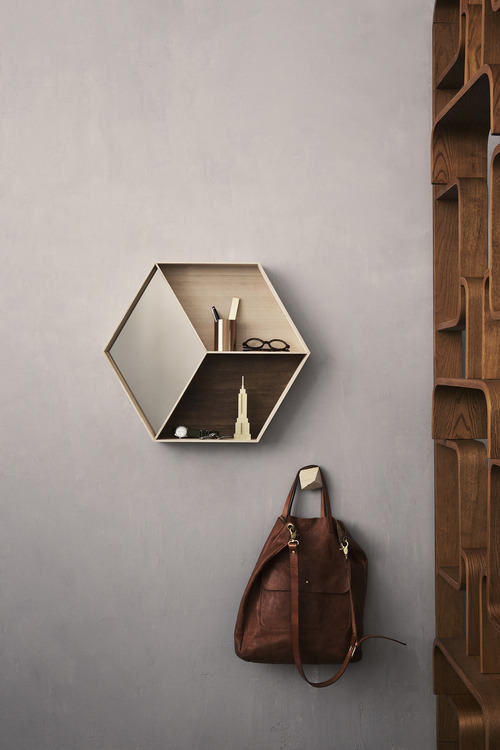 This hexagonal shelf in the entryway is the perfect spot for keeping keys and glasses off countertops.