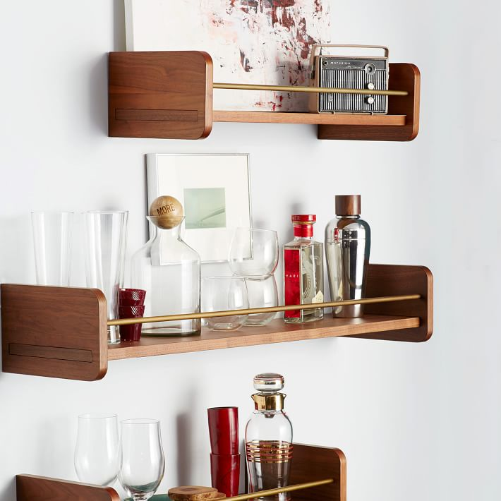 These midcentury modern shelves from the West Elm give any small spaces like a wetbar a big design boost.