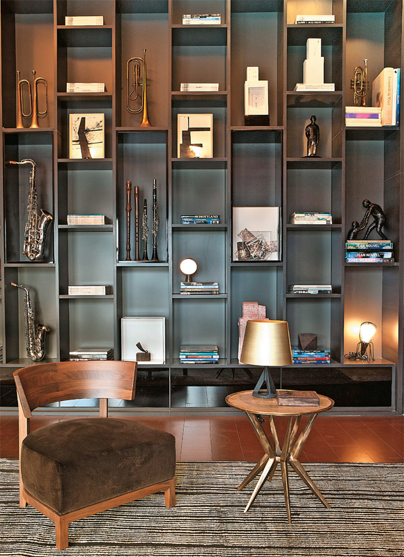 Staggered shelves like this study provide a sophisticated look to any study, library, or coffee shop.