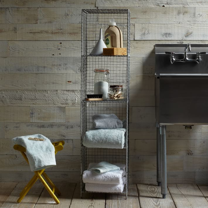 This wire shelving space from West Elm is perfect for an industrial modern bath or living room.