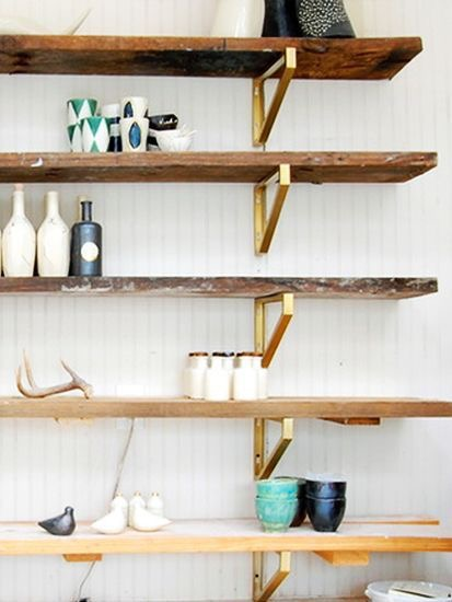 Try an ombre effect with the wood shelves and pair with brass brackets.