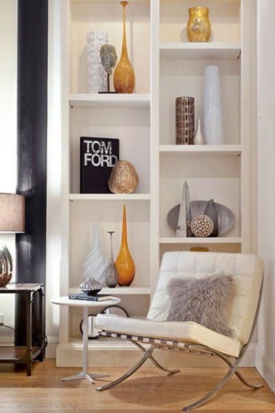Any chic living room should have a staggered bookshelf.