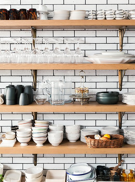 White subway tiles provide a stylish backdrop for an open kitchen with traditional brackets.