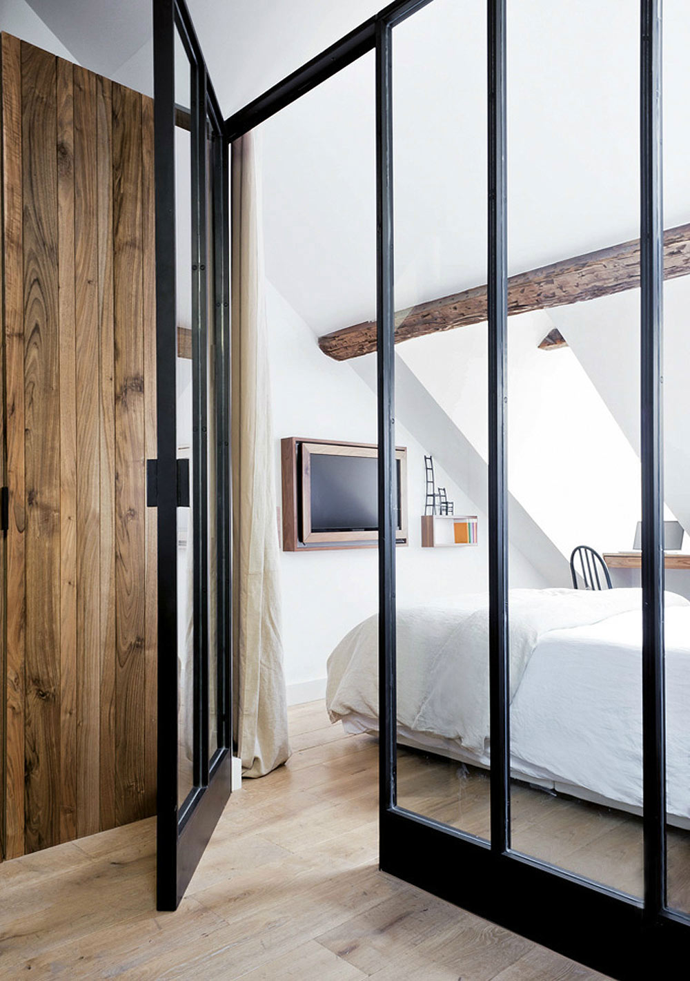 I love this black framed glass door to the bedroom.
