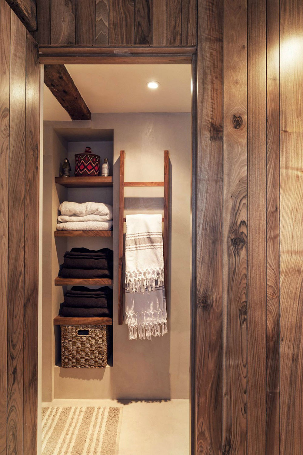 I love a rustic ladder shelf to hang Turkish towels.