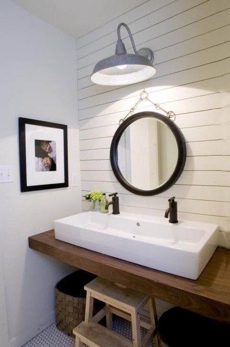 This traditional white wood paneled bathroom is too cute.  The natural wood stool is perfect for the kiddos.