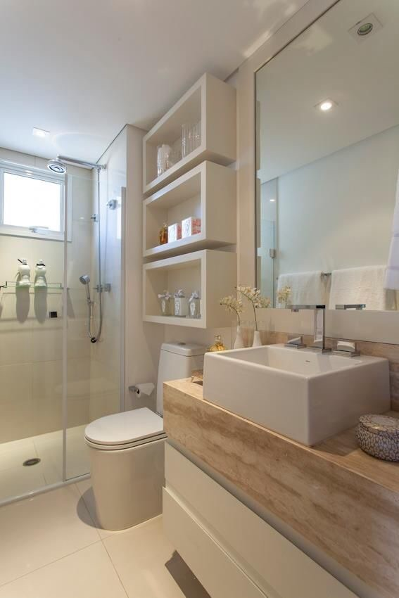 This bathroom is too cute and perfect for a young family.  It's stylish and functional with cute shelving and easy-to-reach hand towel holders.