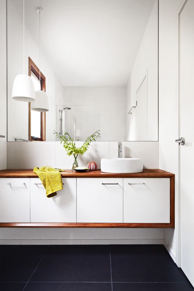 Midcentury modern bathrooms always add an edgy feel that is easy to pull off.