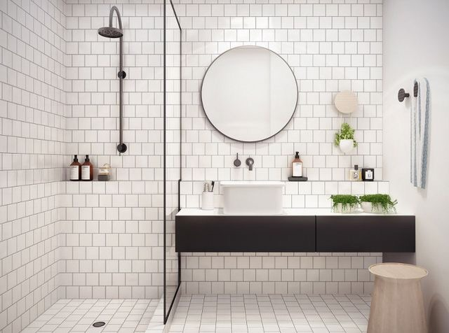 White subway tiles with dark grouting add unmatched industrial style to any room.  Best of all, it's highly functional and easy to clean.  Pair it with lush green moss or plants like this bathroom for a pop of color.